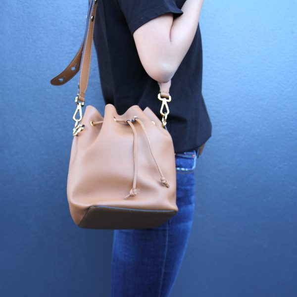Model Holding Fendi Mon Trésor leather bucket bag